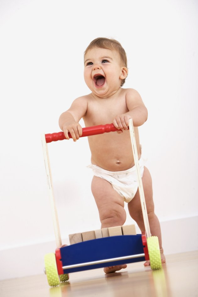 Mandatory Credit: Photo by OJO Images/REX (839559a) MODEL RELEASED Baby walking with push cart VARIOUS